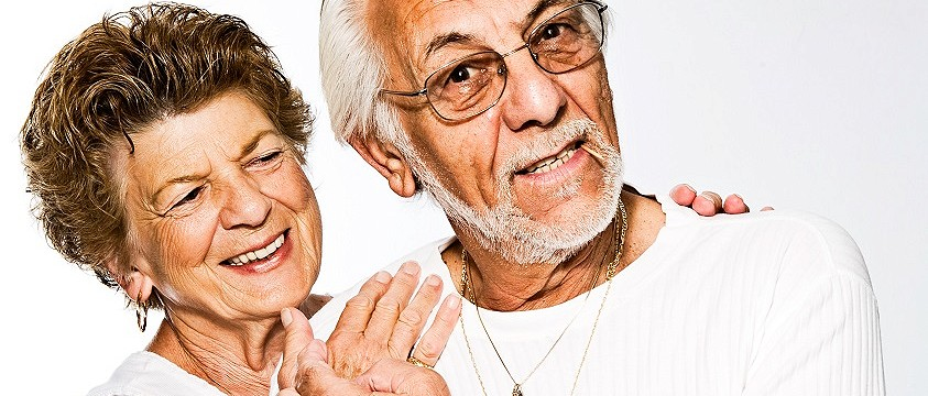 A stock photo of a older couple laughing and posing together