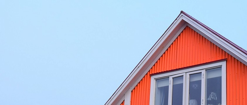 A stock image of the top of an orange coloured house