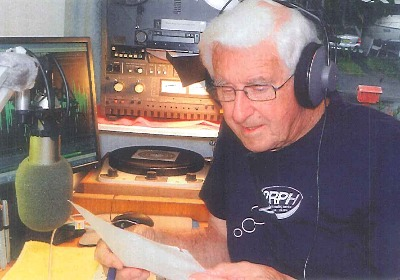 photo Bob Hargreaves reading on air in studio