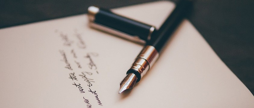 A stock image of an old pen and paper