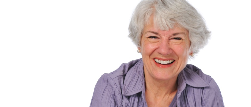 smiling woman, white hair, mauve shirt
