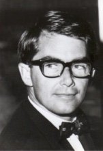 black and white photo, young man in dinner jacket, glasses