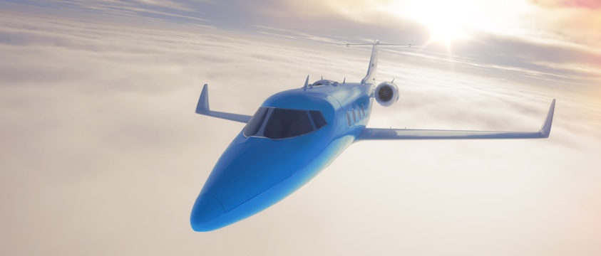 sleek blue passenger jet in flight