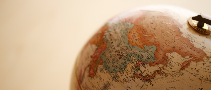 old fashioned globe of earth, looking at Russia and China