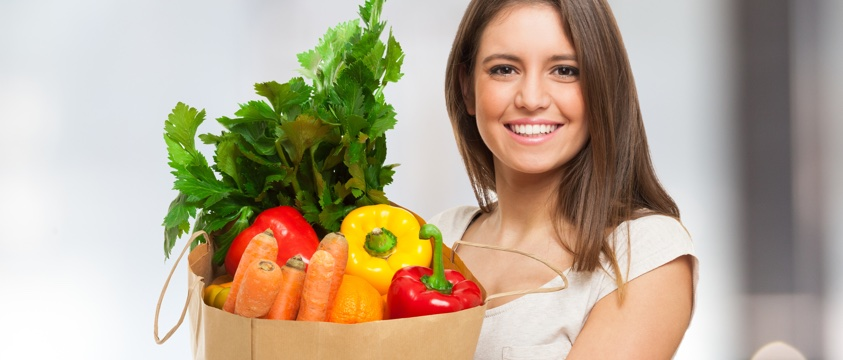 girl with shopping bag full of fresh veg and fruit