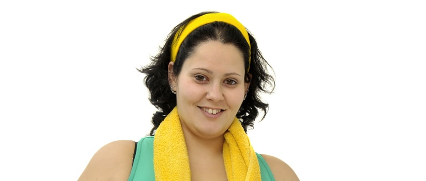 overweight smiling girl with gym gear and yellow towel
