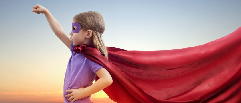 girl, side on, dressed as super hero, long cape