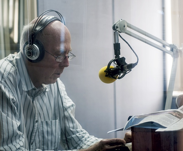 presenter at microphone, reading