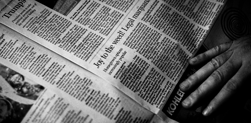 A stock image of black and white newspapers