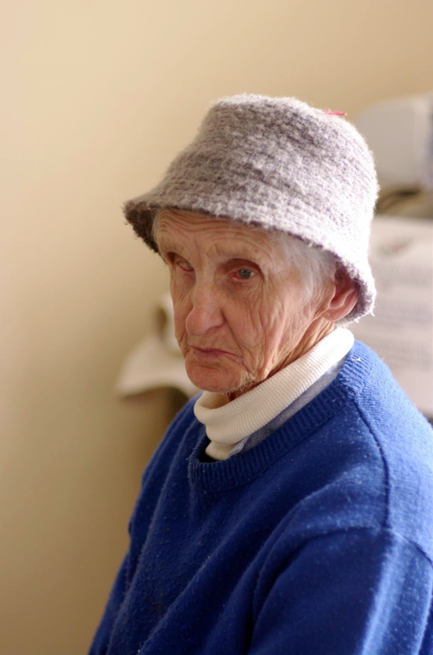 older woman, felt hat, looks to her left